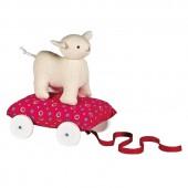 Mouton écru sur coussin à roulettes fuchsia (24 cm) - Trousselier