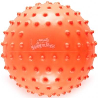Balle tactile fluo orange  par BabyToLove