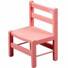 Chaise basse en bois massif laqué rose  par Combelle
