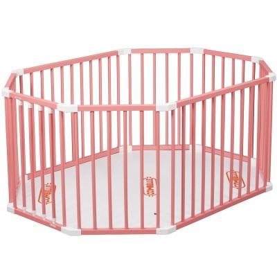 Parc bébé ovale en bois massif laqué rose  par Combelle